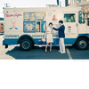 Vintage-bride-and-groom-eat-ice-cream-in-front-of-vintage-ice-cream-truck-downtown-philly-wedding.square