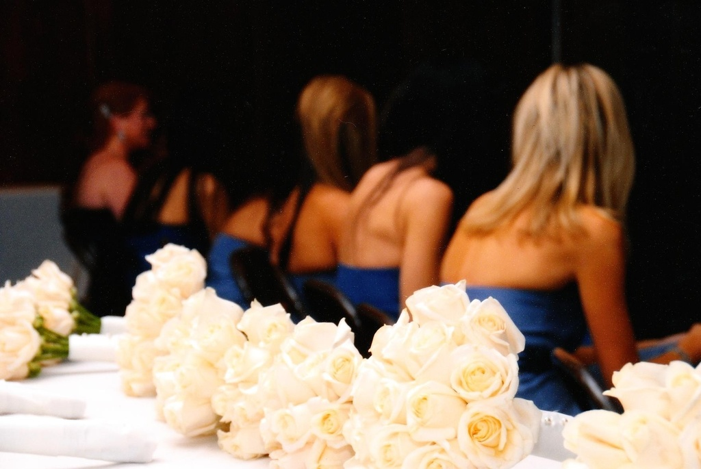 These four bridesmaids match from their cobalt blue bridesmaids' dresses to their white rose bouquet