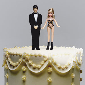 Let's hope that this white wedding cake with yellow flowers and a groom and stripper cake topper is