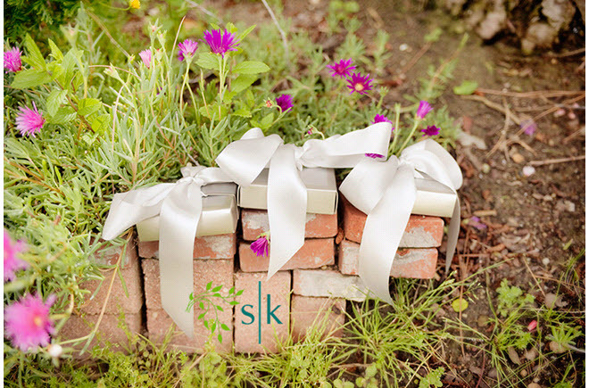 Wedding-detail-shot-wedding-gifts-for-guests-tied-with-white-ribbon-orange-county-california-wedding.full