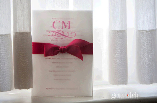 Wedding detail shot- white monogram wedding invitation with pink fuchsia calligraphy