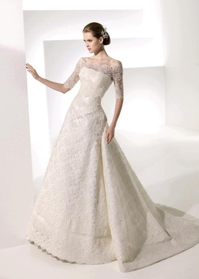 Beautiful lace off-the-shoulder long sleeve wedding dress by Manuel Mota