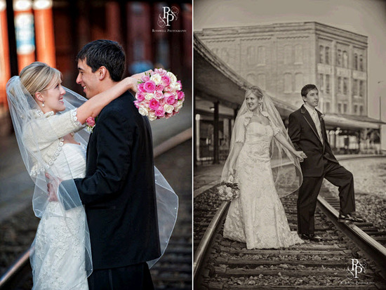 Bride and groom pose outside on rail road tracks after saying I Do