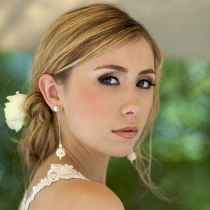 photo of Beautiful drop pearl cluster bridal earrings with loose bridal updo