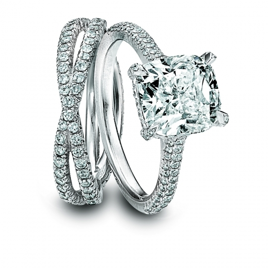 Platinum cushion cut engagement ring and platinum wedding band by Kwiat