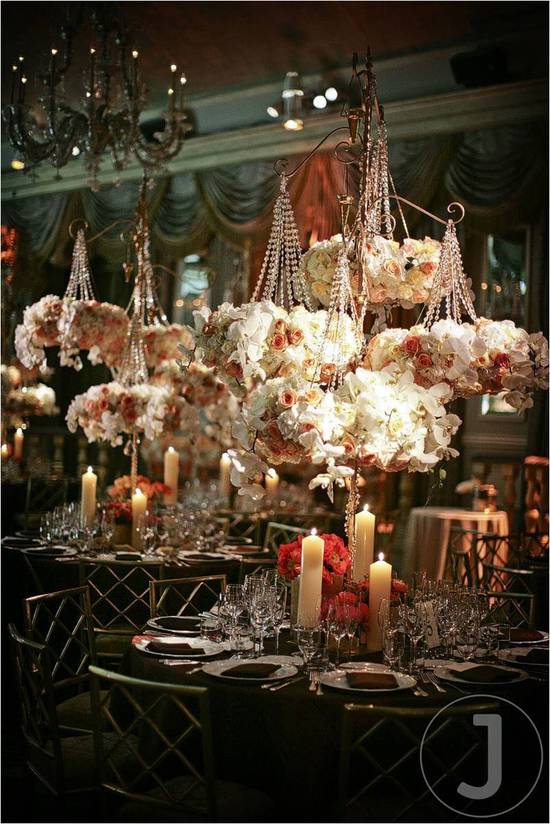 This romantic wedding tablescape is created with hanging flowers and dusty rose candles. It creates