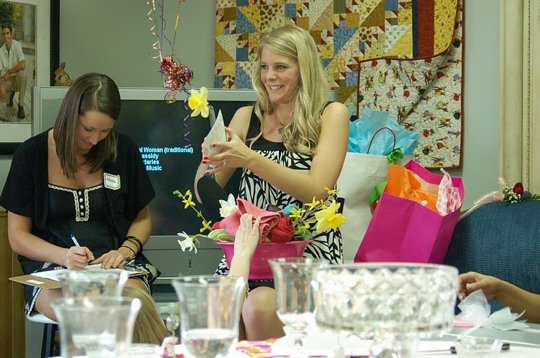 This bride is certainly getting her share of gifts at her semi-formal bridal shower.