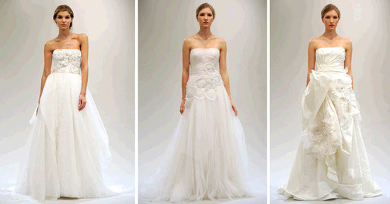 Romantic a-line strapless wedding dresses by Reem Acra, with clouds of tulle and floral applique