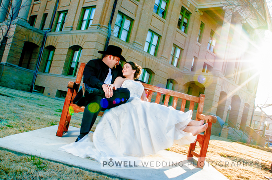 100219-wedding-photography-Georgetown-TX-Williamson-County-Courthouse-bench-sun-flare