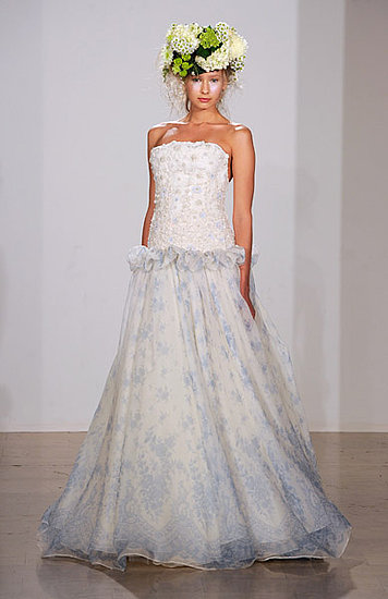 Lovely strapless wedding dress with white appliqued bodice and sky blue and white patterned skirt