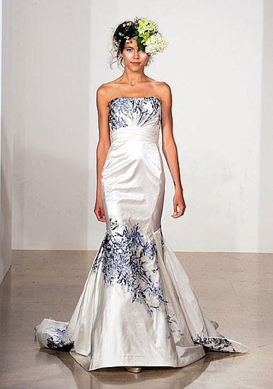 Strapless mermaid wedding dress with bunches of navy and sky blue florals