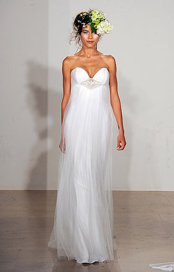 Deep sweetheart neckline wedding dress with jeweled detail at bust