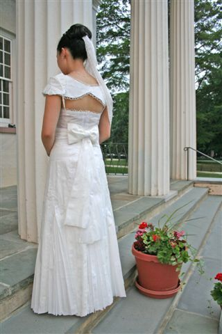 This white wedding dress with a bow detail and shoulder shrug is made from toilet paper.