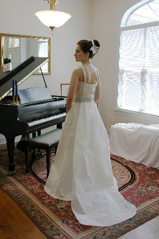 This beautiful white wedding dress seen from the back was made from toilet paper.
