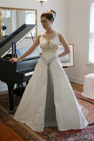 Yes, this white wedding dress with it's green accent and sash and sweetheart neckline was made from