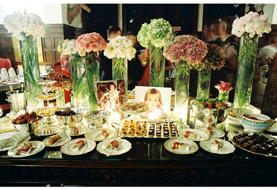 Gorgeous dessert table adorned with high and low floral centerpieces