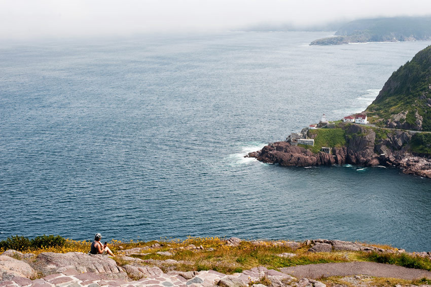 Gorgeous-outdoor-wedding-photo-island-in-canada-bride-sits-on-rocks.full