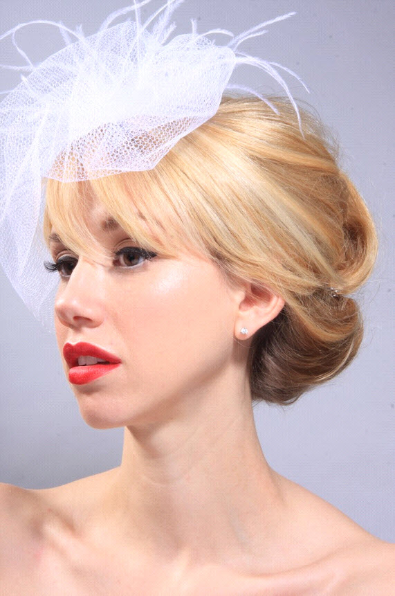 Beautiful vintage-inspired bridal hairstyle with white ...