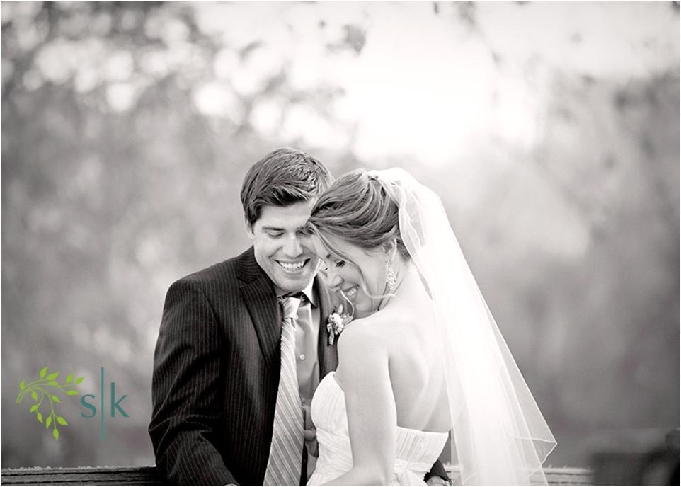 Artistic-black-white-wedding-photo-bride-white-wedding-dress-mid-length-traditional-veil-groom-in-suit-long-tie.full