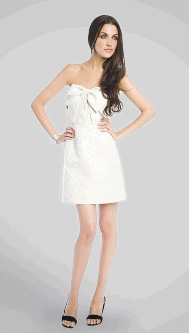 Above the knee strapless white cocktail frock perfect for rehearsal dinner or wedding reception