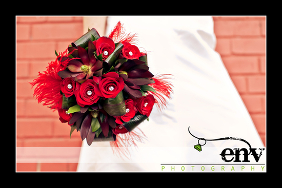 Stunning statement bridal bouquet- deep red roses and flowers, feathers and rhinestones