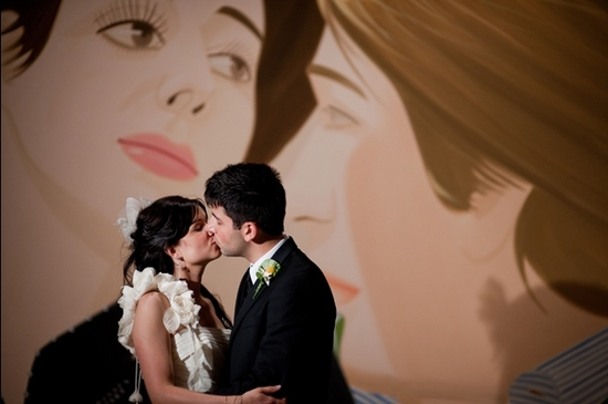 Bride (in ivory Ines Di Santo wedding dress and birdcage veil) and groom kiss in front of famous pai