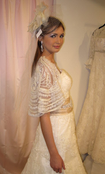 Stunning vintage-inspired ivory lace wedding dress with champagne beaded sash and stunning bolero
