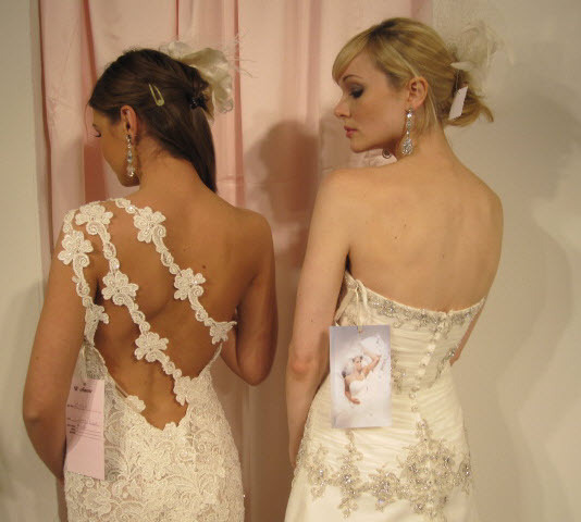 Beautiful romantic ivory wedding dresses with loads of lace, floral details and beautiful beading