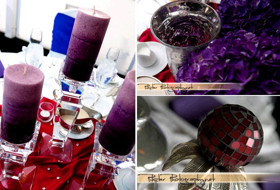 Purple pillar candles, red tablecloth, purple and ruby jewels decorate wedding reception tables