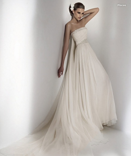 Beautiful grecian-inspired strapless ivory wedding dress