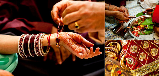 Bride reaches henna-covered hand out as traditional east Indian bangles are placed around her wrist