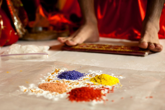 Colorful blue, red, yellow, and orange henna powder is mixed for religious Mendi ceremony