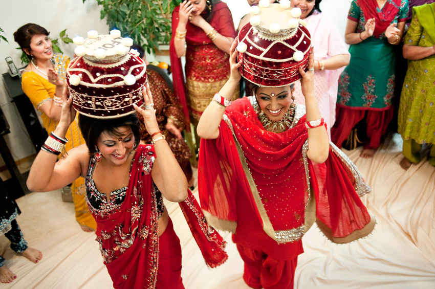 Pre-wedding hindu ceremony- women carry ornate baskets on head