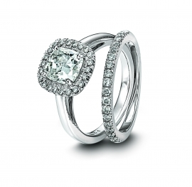 This Martin Flyer engagement ring and wedding ring set has a square cut diamond in a platinum settin
