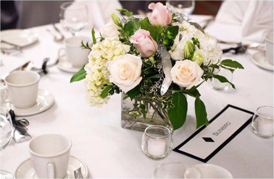 Personalized-wedding-idea-guest-tables-at-reception-name-different-ski-slopes-the-couple-love-low-peach-pink-ivory-table-centerpiece.full