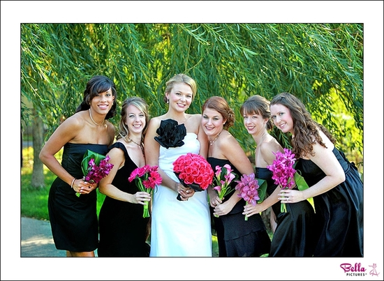Bridesmaids wear their own little black dresses, hold unique pink bridesmaids bouquets