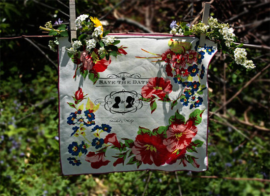 Lovely white, red and green floral handkerchief save-the-date hangs outside