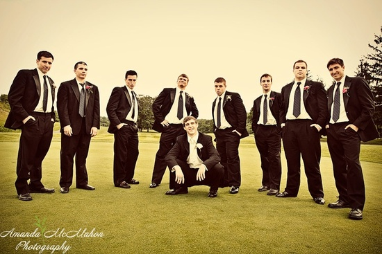 These grooms and groomsmen are looking dashing at this outdoor wedding.