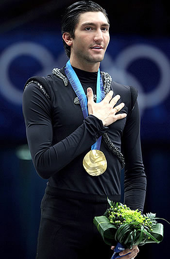 Evan Lysacek receives Gold Olympic medal after skating in Vera Wang