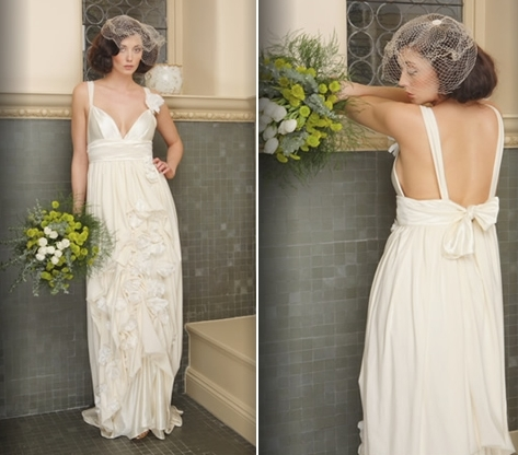 Romantic and flirty empire waist wedding dress featuring hand-sewn organic linen flowers