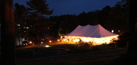Tent on the waterfront at night