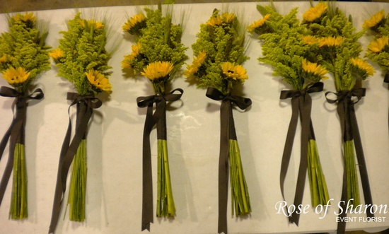 These wildflower bouquets use sunflowers to create a chocolate brown, yellow, and sage green color p