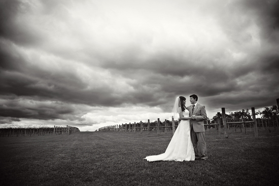 Stunning artistic wedding photo, with cloudy sky in background