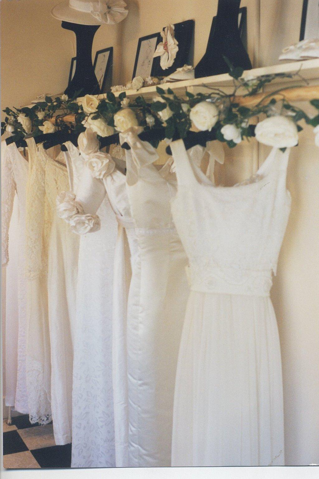 Amy-jo-tatum-bridal-couture-wedding-dresses-hang-on-rack-lace-applique.full