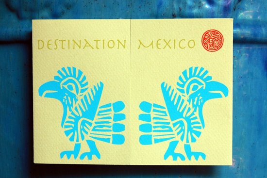 The invitation to the destination wedding in Cabo Mexico is done in yellow and blue.