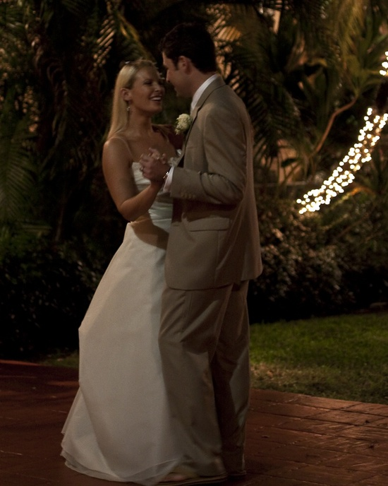 This photo of a bride in a white dress and a groom in a tan suit was shot by the bride's uncle.