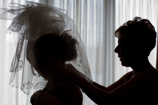 Artistic wedding photo of bride's silhouette with stunning voluminous veil
