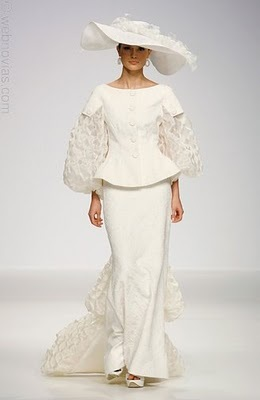 This two piece white wedding dress features long sleeves, lots of lace, and a southern style hat.