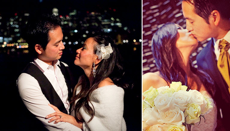 Bride-and-groom-with-boston-skyline-white-flower-in-hair-white-fur-shrug-kiss-lovingly.full