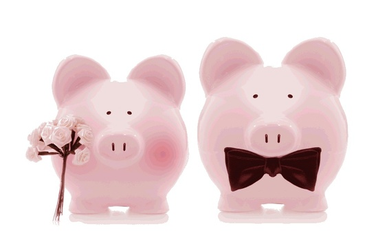 This piggy bank bride and groom show the need for wedding budgeting.